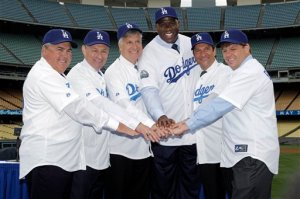 "New owners of the Los Angeles Dodgers, from left, Robert Patton, Stan Kasten, Mark Walter, Earvin ""Magic' Johnson,"" Peter Guber, and Todd Boehly pose for a photo at Dodger Stadium in Los Angeles on Wednesday, May 2, 2012. The $2 billion sale of the team to Guggenheim Baseball Management was finalized Tuesday. (AP Photo/Damian Dovarganes)"